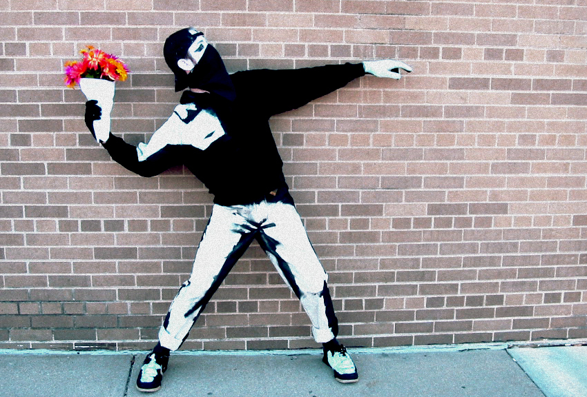 "Jason McDowell (aka Little Tiny Fish) as Banksy's ""Flower Bomber."""